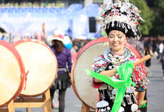 Miao nationality woman beat a drum. And dance to celebrate the local festival at fenghuang ancient town,china oct,13,2013 stock photos