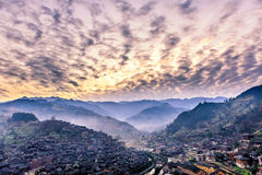 Miao village. Xijiang miao village, largest village in Guizhou Miao ethnic minority under the morning of sunrise royalty free stock image