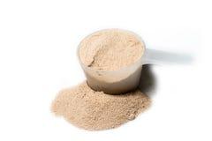 Miarka czekoladowy smak proteiny proszek odizolowywający zdjęcia stock