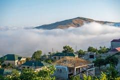 Miasteczko pod cumulus chmurami Fotografia Royalty Free