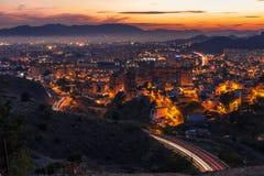Miasto Malaga przy półmrokiem Zdjęcia Royalty Free