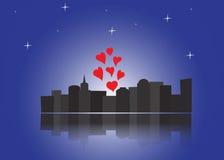 Miasto przy nocą z sercami Zdjęcia Royalty Free