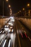 Miastowy nocy ruch drogowy Fotografia Royalty Free