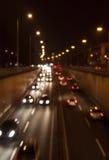 Miastowy nocy ruch drogowy Zdjęcia Stock