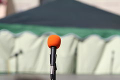 Mic. A microphone on blurred background Royalty Free Stock Photography