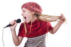 有mic的年轻女歌手 库存图片