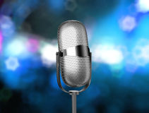 Mic angled. Microphone angled on stage over defocused background Royalty Free Stock Photos