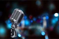 Mic on background. Announcement radio amusement announce announcer audience Royalty Free Stock Photo
