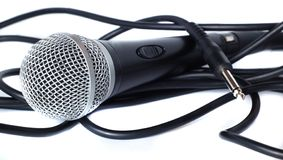 Mic and Cable spool. A mic drowning in its cable Royalty Free Stock Images