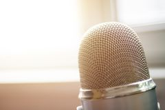 Microphone close up. Mic close up shot in studio, seminar or meeting room in blur focus for copy space stock photos
