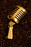 Mic & Coffee (gold) 2. Golden retro microphone on brown\gold roasted coffee beans Stock Images