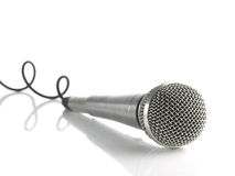 Mic with curled cable. A dynamic mic with a curled cable over white Stock Photography