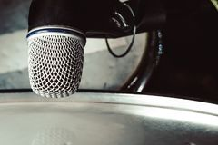 MIC the drums close-up. Microphone for drum set-up on wall background royalty free stock photo