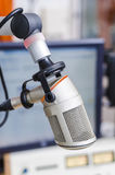 Mic in front of the control panel. In broadcasting studio Royalty Free Stock Images