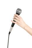 Mic in hand. Woman's hand holding a microphone. isolated on white background Royalty Free Stock Photo