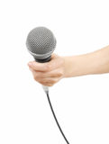 Mic in hand. Woman's hand holding a microphone. isolated on white background Stock Photo