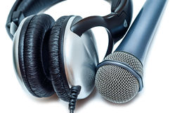 Mic and headphones. Close-up isolated on white background Royalty Free Stock Images