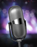 Mic on stage. Mic angled on stage over defocused background Royalty Free Stock Photography