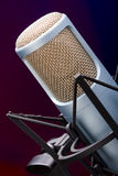 Mic on stage 4. Mic on stage with colorful background, shallow depth of field Royalty Free Stock Image