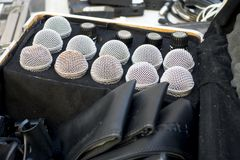 Old beat up mics placed in a traveling box. Mic for stage performers in case royalty free stock photos