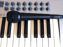 Mic and synth keys front side view closeup Stock Photos