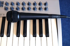 Mic and synth piano roll front side view closeup Stock Images