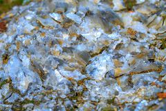 The mica sheets and quartz silicate minerals. Bare geological ro royalty free stock photo