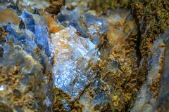 The mica sheets and quartz silicate minerals. Bare geological ro royalty free stock images
