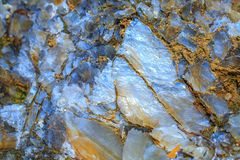 The mica sheets and quartz silicate minerals. Bare geological ro stock photo