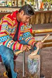 Miccosukee Indian. Carving wooden cooking utensils. The Miccosukee Tribe is a recognized Indian Tribe residing in Florida Everglades west of Miami. The  Village Royalty Free Stock Photography