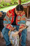 Miccosukee Indian. Carving wooden cooking utensils. The Miccosukee Tribe is a recognized Indian Tribe residing in Florida Everglades west of Miami. The  Village Stock Photo