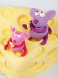 Mice on cheese fondant cake Stock Image