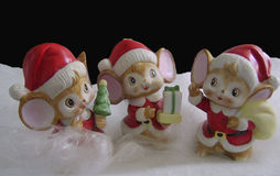 Mice in Santa Outfit. Three mice dressed in Santa Outfits in a winter land scene Royalty Free Stock Photography