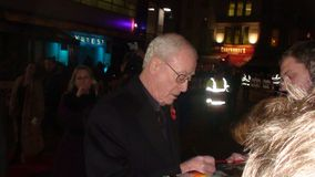 Michael caine. Sir michael caine signing autographs at the premiere of the movie harry brown on 2009 in london Stock Photo