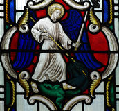 Michael defeating the dragon (stained glass) Stock Photos