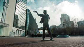Michael Jackson sculpture installed. Video. Monument to Michael Jackson on the pedestrian.  Royalty Free Stock Photography