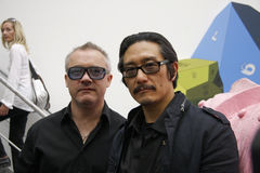 Michael Joo, Damien Hirst. BERLIN-APRIL 30, 2010 : Michael Joo, Damien Hirst at the opening of the exhibition Have You Ever Really Looked at the Sun?, Galerie royalty free stock images