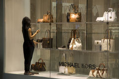 Michael Kors handbags department store. A shop worker was decorating the window of Michael Kors shop in Alderwood Mall Lynnwood, near Seattle Stock Images