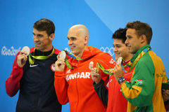 Michael Phelps usa, Laszlo Cseh hun, Joseph Uczy kogoś SGP Le Clos RSA i Czad podczas medal ceremonii (L) Fotografia Stock