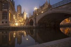 Michael s bridge and city belfot of Gent in fog Stock Photos