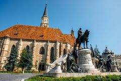 Michael's church in Cluj Napoca. Michael's church and Matthias Corvinus monument in Cluj Napoca in Romania Stock Photography