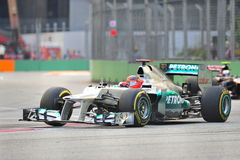 Michael Schumacher racing in F1 Singapore GP Royalty Free Stock Photo