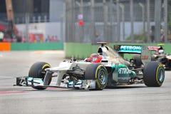 Michael Schumacher som är tävlings- i GP för F1 Singapore Royaltyfri Foto