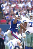 Michael Strahan. Defensive End Michael Strahan of the New York Giants celebrates his sack of quarterback Troy Aikman of the Dallas Cowboys Stock Images