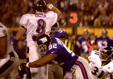 Michael Strahan, New York Giants, Super Bowl XXXV. New York Giants DL Michael Strahan puts a hit on Baltimore Ravens QB Trent Dilfer during Super Bowl XXXV. ( Royalty Free Stock Photos