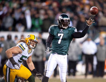 Michael Vick. Philadelphia Eagles quarterback Michael Vick throws a pass at Green Bay Packer linebacker Clay Matthews gives chase in 2010 NFC playoff game Stock Photography