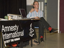 Micheal Axworthy speaking at the Amnesty Inter Stock Photos