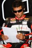 Michel Fabrizio #84 på röda jäklar 1000 för Aprilia RSV4 fabrik Roma Superbike WSBK Arkivbilder