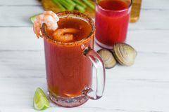 Michelada beer with tomato juice, shrimps, and lemon, mexican drink cocktail in mexico. Michelada beer with tomato juice, and lemon, mexican drink cocktail in stock images