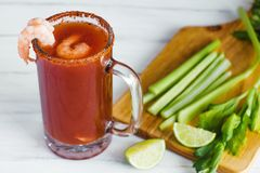 Michelada beer with tomato juice, shrimps, and lemon, mexican drink cocktail in mexico. Michelada beer with tomato juice, and lemon, mexican drink cocktail in royalty free stock photography